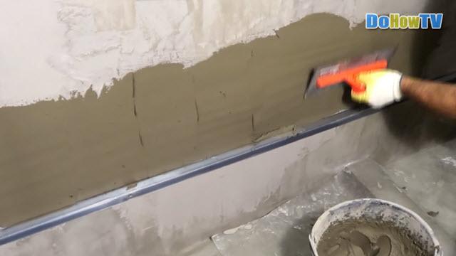 Укладка настенной плитки в ванной комнате